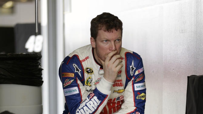 Dale Earnhardt Jr. waits in the garage before going out on the track during NASCAR auto race testing at Daytona International Speedway, Thursday, Jan. 10, 2013, in Daytona Beach, Fla. (AP Photo/John Raoux)