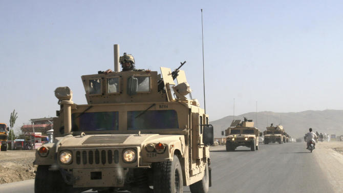 FILE - In this Aug. 2, 2007 file photo, a U.S. military convoy passes the main road of the Ghazni province, west of Kabul, Afghanistan. The U.S. military estimates that $360 million spent on combat support and reconstruction contracts in Afghanistan has ended up in the hands of people the American-led coalition has battled for nearly a decade: the Taliban, criminals and local power brokers with ties to both. (AP Photo/Rahmat Gul, File)