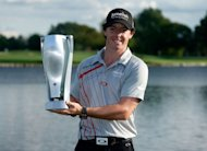 Rory McIlroy of Northern Ireland poses with trophy after his victory at the BMW Championship at Crooked Stick Golf Club in Carmel, Indiana