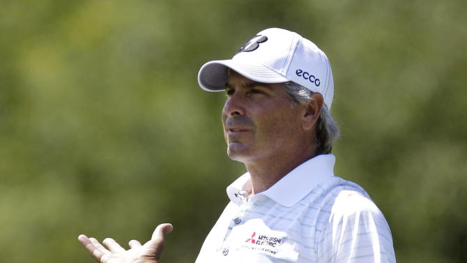 Fred Couples reacts on the 14th hole after his second shot during the first round of the Senior PGA Championship golf tournament at the Harbor Shores Golf Club in Benton Harbor, Mich., Thursday, May 24, 2012. (AP Photo/Carlos Osorio)