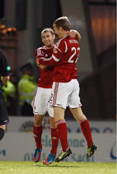 Aberdeen's Niall McGinn, left, and Mark Reynolds celebrate Aberdeen's fourth goal