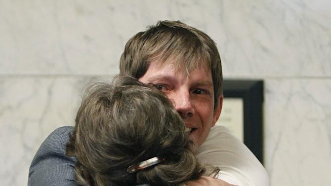 FILE - In this April 23, 2010, file photo, shows plaintiff Kerry Lewis hugging his mother Helen Caldwell following court in Portland, Ore. A jury on Friday ordered the Boy Scouts of America to pay $18.5 million to Lewis who was sexually abused by a former assistant Scoutmaster in what is believed to be the largest such award against the organization. The Oregon Supreme Court has approved the release of 20,000 pages of so-called perversion files compiled by the Boy Scouts of America on suspected child molesters within the organization for more than 20 years, giving the public its first chance to review the records. (AP Photo/Rick Bowmer, File)