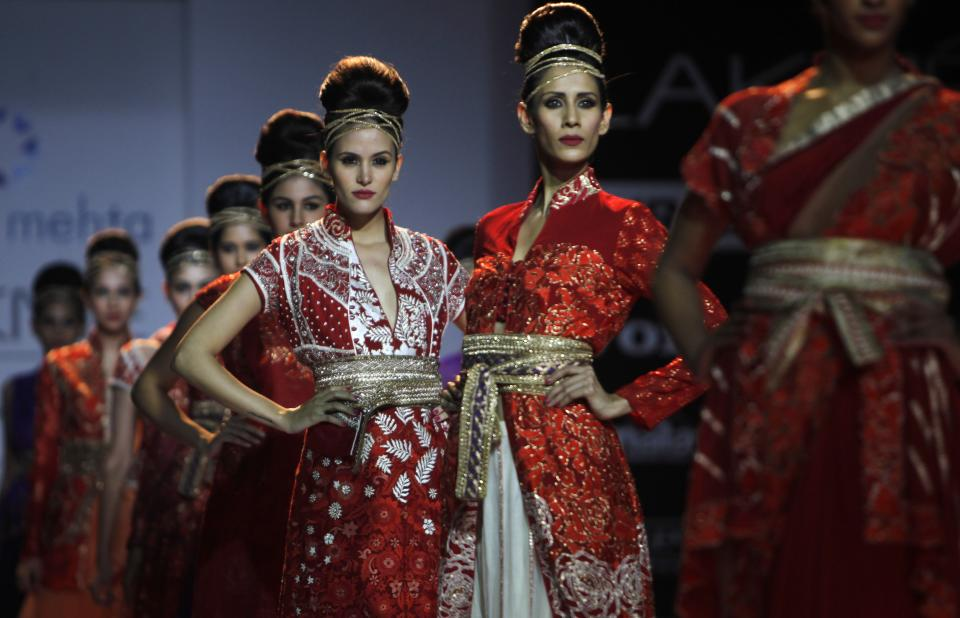 Indian models display creations by  Krishna Mehta during the Lakme Fashion Week in Mumbai, India, Sunday, Aug. 5, 2012. (AP Photo/Rafiq Maqbool)