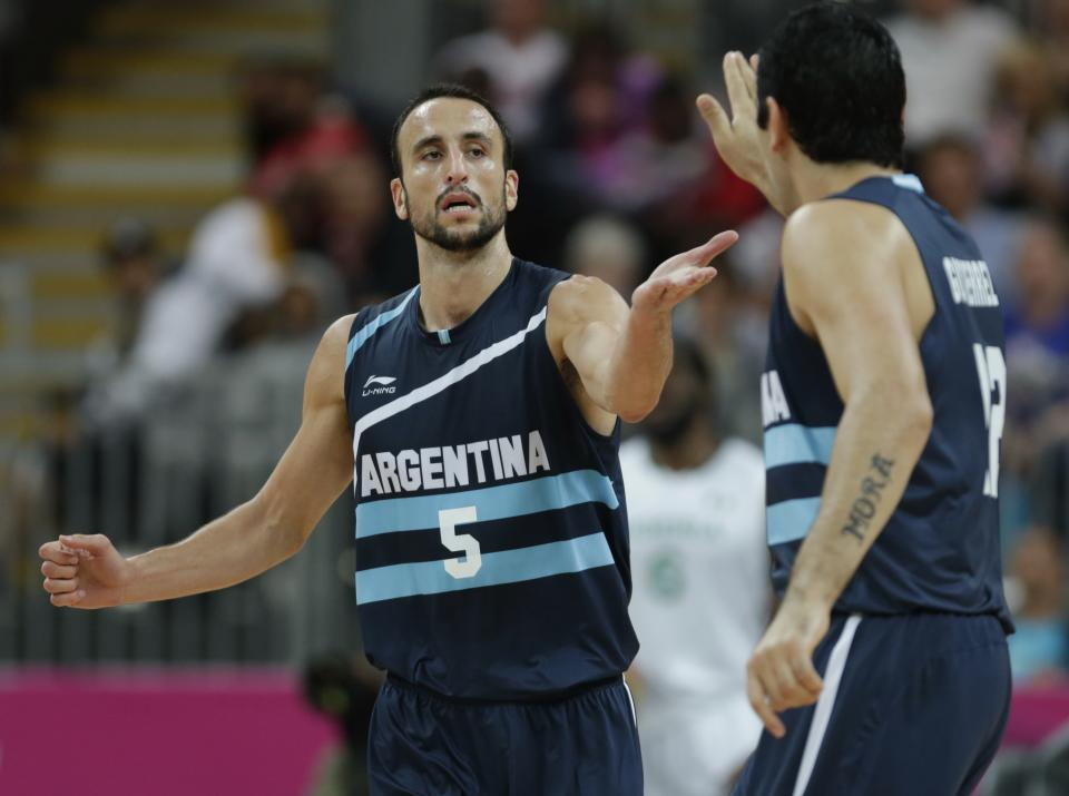 Argentina's Manu Ginobili, left, congratulates Leonardo Gutierrez after his 3-pointer against Nigeria during a men's basketball game at the 2012 Summer Olympics, Saturday, Aug. 4, 2012, in London. (AP Photo/Charles Krupa)