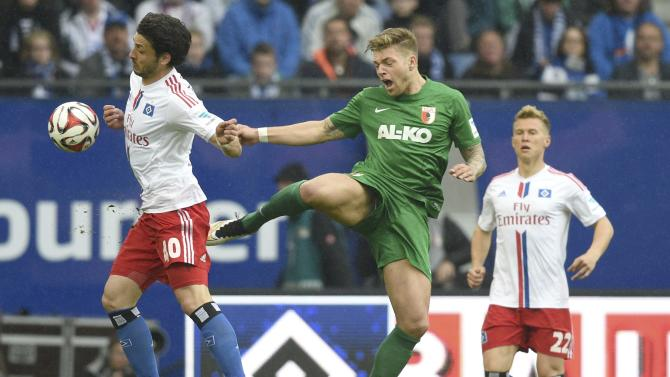 Hamburg SV's Kacar and FC Augsburg's Esswein fight for the ball during their German Bundesliga first division soccer match in Hamburg