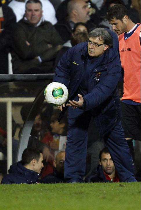 Barcelona's coach Gerardo Tata Martino from Argentina passes the ball during their la copa del Rey soccer match against Cartagena at the Cartagonoba stadium in Cartagena, Spain, Friday, Dec. 6, 20