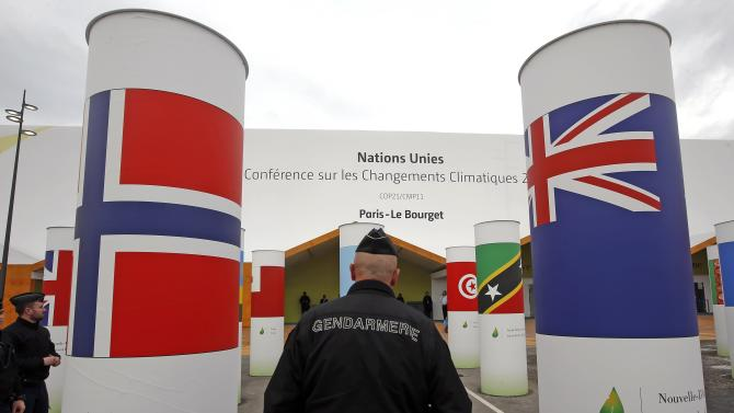 A French gendarme patrols in front of the entrance at the venue for the World Climate Change Conference 2015 at Le Bourget, near Paris