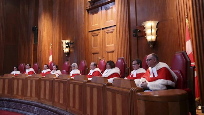 Canada's Supreme Court Justices take part in a welcoming ceremony in Ottawa