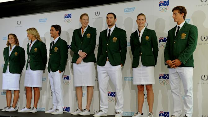 Australian Olympic team members (L-R), Libby Trickett, Naomi Flood, Kynan Maley, Lauren Jackson, Adam Gibson, Sarah Tait and Murray Stewart, model the official Australian Olympic Opening Ceremony uniform in Sydney on May 3, 2012. For the first time in Australian history, the Opening Ceremony uniform of the 2012 Australian Olympic team was unveiled ahead of the London 2012 Olympics.  AFP PHOTO / Greg WOODGREG WOOD/AFP/GettyImages