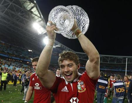 British and Irish Lions' Leigh Halfpenny celebrates with the Tom Richards trophy after winning their series over the Australia Wallabies after their third and final rugby union test match at ANZ stadi