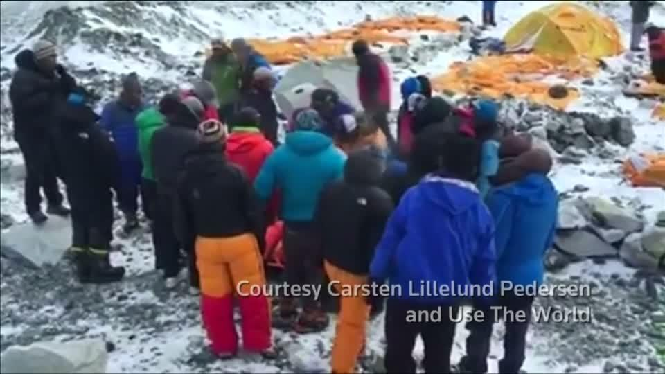 Mountaineers, guides stream from Everest after avalanche
