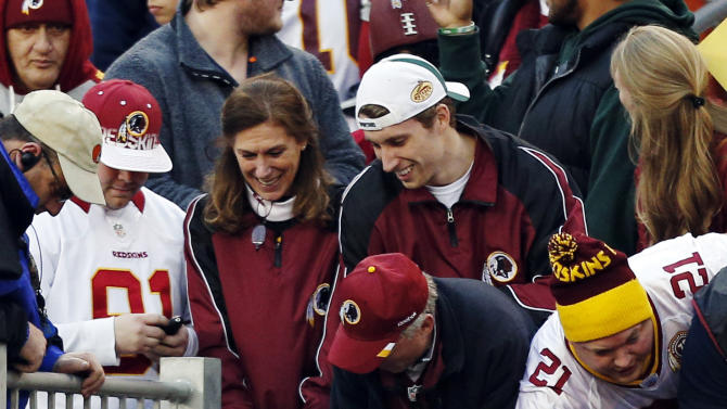 Washington Redskins quarterback Kirk Cousins (12) greets fans after their 38-21 win over the Cleveland Browns in an NFL football game in Cleveland, Sunday, Dec. 16, 2012. Cousins threw for 329 yards and two touchdowns in his first NFL start. (AP Photo/Rick Osentoski)