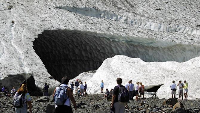 In this July 2010 photo, visitors examine the Big Four Ice Caves in the Mt. Baker-Snoqualmie National Forest near Granite Falls, Wash. The Snohomish County sheriff's office says rescuers responded to a report of a partial collapse of the ice caves Monday, July 6, 2015. (Mark Mulligan/The Herald via AP)
