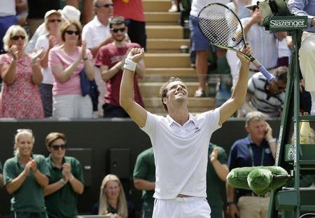 Richard Gasquet of France celebrates after winning his match against Nick Kyrgios of Australia at the Wimbledon Tennis Championships in London