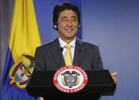 Japan's Prime Minister Shinzo Abe smiles during a news conference at the presidential palace in Bogota
