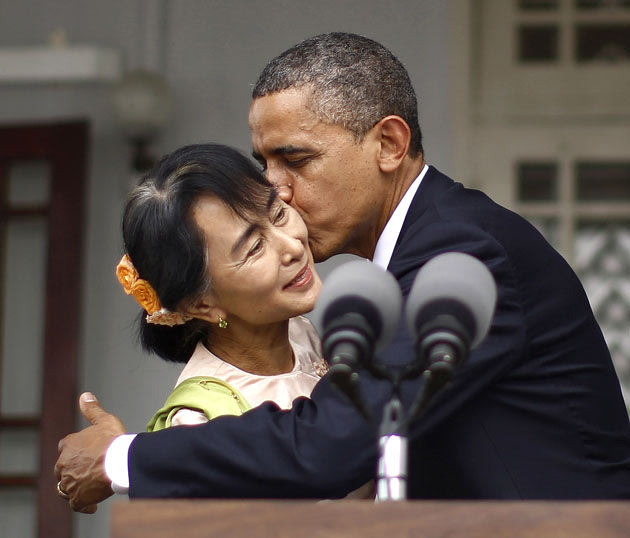 U.S. President Obama kisses Suu Kyi following joint remarks at her residence in Yangon