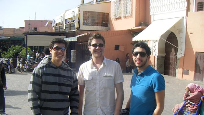 "This Feb. 7, 2010 photo provided by Jake Hug shows him, center, with fellow students Brahim Mellouli, left, and Toshiro Baum from the International Institute of Higher Education in Morocco, in the Djemma el-Fna square in Marrakech, Morocco during a road trip. Hug, a recent graduate of Elmhurst College in Illinois, was looking for a ""big change from Chicago."" With little knowledge of the country or Arabic, he took a full year away to study in a Moroccan university where he was the only American. He was grateful his program didn't mollycoddle him. Moroccans were welcoming and he resisted the temptation to hang out with his compatriots. After decades of laissez-faire and faith that just breathing the air in foreign lands broadens horizons, American colleges and international programs are pressing students harder to get out of their comfort zones. (AP Photo)"