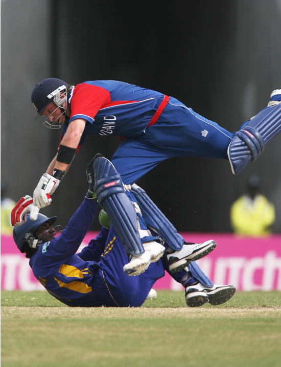 ST. JOHN'S, ANTIGUA AND BARBUDA - APRIL 04:  Ian Bell of England jumps over Kumar Sangakkara of Sri Lanka during the ICC Cricket World Cup Super Eights match between England and Sri Lanka at the Sir V