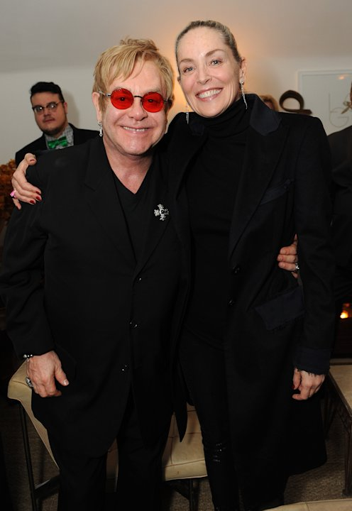 "Sharon Stone, right, and Elton John attend LoveGold/EJAF Celebrate ""How to Survive a Plague"" at Chateau Marmont on February 22, 2013 in Los Angeles. (Photo by Jordan Strauss/Invision for LoveGold/AP I"
