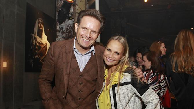 IMAGE DISTRIBUTED FOR FOX HOME ENTERTAINMENT - Producer Mark Burnett, left, and actress Kristin Chenoweth pose during the celebration of the April 2 Blu-ray, DVD, and Digital HD release of THE BIBLE from Twentieth Century Fox Home Entertainment at The Bible Experience, a rare exhibit of biblical artifacts,  on Tuesday, March 19, 2013, in New York. (Photo by Mark Von Holden/Invision for Fox Home Entertainment/AP Images)