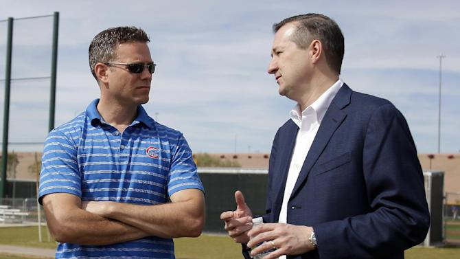 Chicago Cubs Owner Tom Ricketts, right, talks to President of Baseball Operations Theo Epstein during spring training baseball practice, Wednesday, Feb. 19, 2014, in Mesa, Ariz
