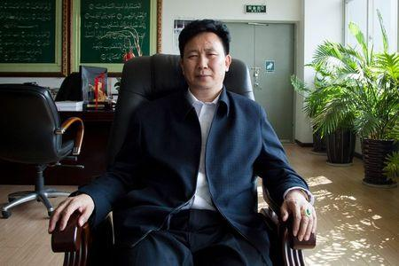 Sipu Enterprises Group Chief Executive Zhang Long poses at his office in Kunming