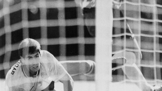 FILE - In this June 22, 1994, file photo, Colombia's Andres Escobar, lies on the ground and watches a shot by America's Eric Wynalda miss the Colombian goal, during the World Cup match, in the Rose Bowl, Pasadena. The Unites States defeated Colombia by two goals to one. Escobar was shot six times by a man employed by two drug traffickers, who had been complaining to him about his blunder 10 days earlier in Los Angeles. Escobar had knocked Colombia out of contention by kicking the ball into his own net in game against the United States. (AP Photo/Draper, File)