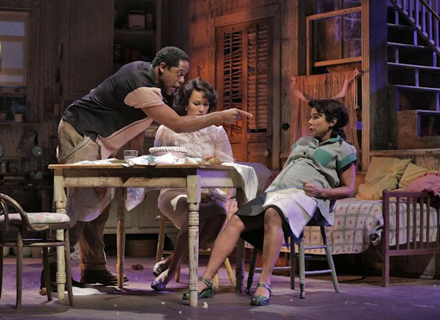 "In this April 2, 2012 photo provided by Springer Associates, from left, Stanley, played by Blair Underwood, lashes out at his wife, Stella, played by Daphne Rubin-Vega next to Blanche, played by Nicole Ari Parker, in a scene from ""A Streetcar Named Desire"" at the Broadhurst Theatre in New York. A talented multi-racial cast tackles Tennessee Williams' Pulitzer Prize-winning play about the clash between an aging and delusional Southern belle and her brutish brother-in-law. It opens Sunday, April 22, 2012. (AP Photo/Springer Associates, Ken Howard)"