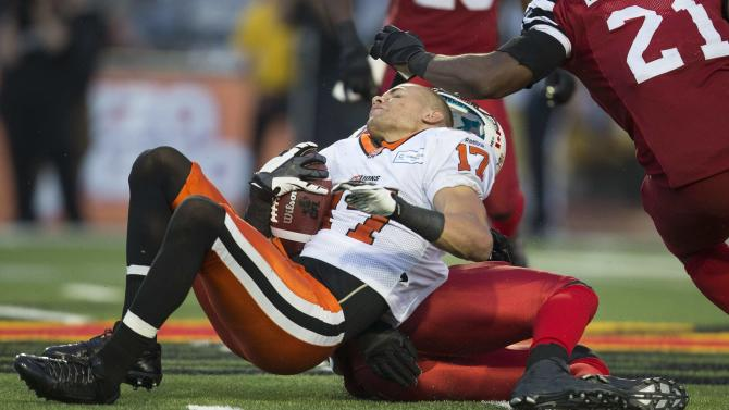 B.C. Lions slot back Nick Moore has his helmet knocked off during the Lions' loss to the Hamilton Tiger-Cats in CFL football action in Guelph, Ontario