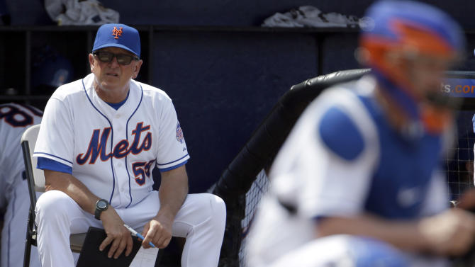 """FILE - In this March 23, 2013 file photo, New York Mets pitching coach Dan Warthen watches during an exhibition spring training baseball game against the Washington Nationals, in Port St. Lucie, Fla. Warthen and the Mets apologized after the team's pitching coach used a racial slur in describing the translator for New York pitcher Daisuke Matsuzaka. """"I apologize for the thoughtless remarks that I made yesterday in the clubhouse,"""" Warthen said in statement released by the team Wednesday, March 12, 2014.(AP Photo/Jeff Roberson)"""