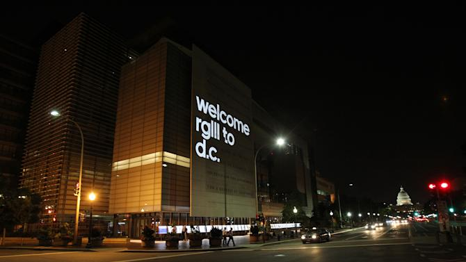 COMMERCIAL IMAGE - adidas welcomes Redskins quarterback Robert Griffin III with an adizero light projection at the Newseum on Thursday, Aug. 23, 2012 in Washington. (Photo by Paul Morigi/Invision for adidas/AP Images)