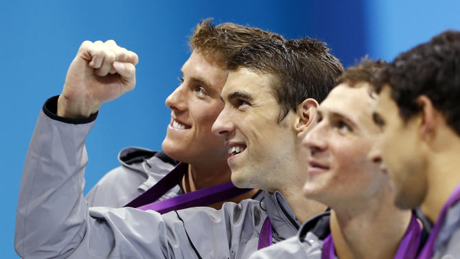 FILE - In this July 31, 2012, file photo, from left, Conor Dwyer, Michael Phelps, Ryan Lochte and Ricky Berens, all of the United States, pose with their gold medals after their win in the men's 4x200-meter freestyle swimming relay at the Aquatics Centre in the Olympic Park during the 2012 Summer Olympics in London. Phelps has added another triumph to his list of accomplishments: The Associated Press male athlete of the year, Thursday, Dec. 20, 2012.(AP Photo/Daniel Ochoa De Olza, File)