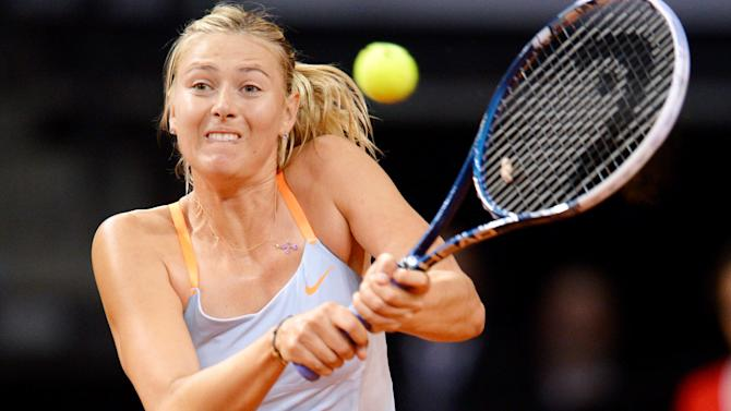Russia's Maria Sharapova hits the ball during the semi-final match against Germany's  Angelique Kerber at the WTA Porsche Tennis Grand Prix in Stuttgart, Germany, Saturday, April 27, 2013. (AP Photo/dpa, Bernd Weissbrod)