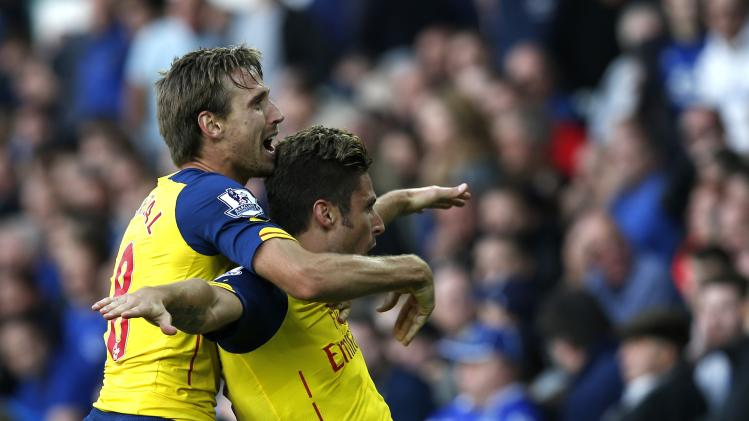 Arsenal's Giroud celebrates after scoring a goal against Everton during their English Premier League soccer match at Goodison Park in Liverpool