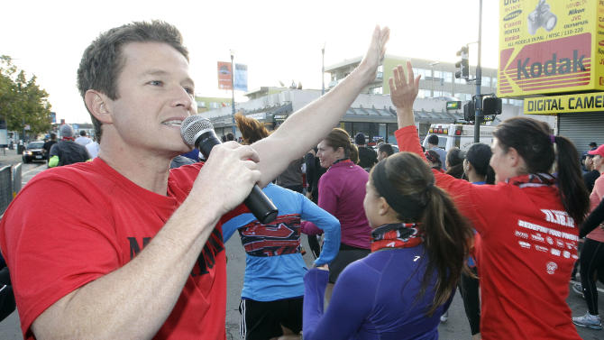 Celebrity host Billy Bush greets Urbanathletes at the start of the Men's Health Urbanathlon, Sunday, Nov. 18, 2012 in San Francisco. The Men's Health Urbanathlon is a rigorous 9 mile course, packed with challenging urban obstacles set against the backdrop of iconic city landmarks.(Photo by Tony Avelar/Invision for Men's Health/AP Images)