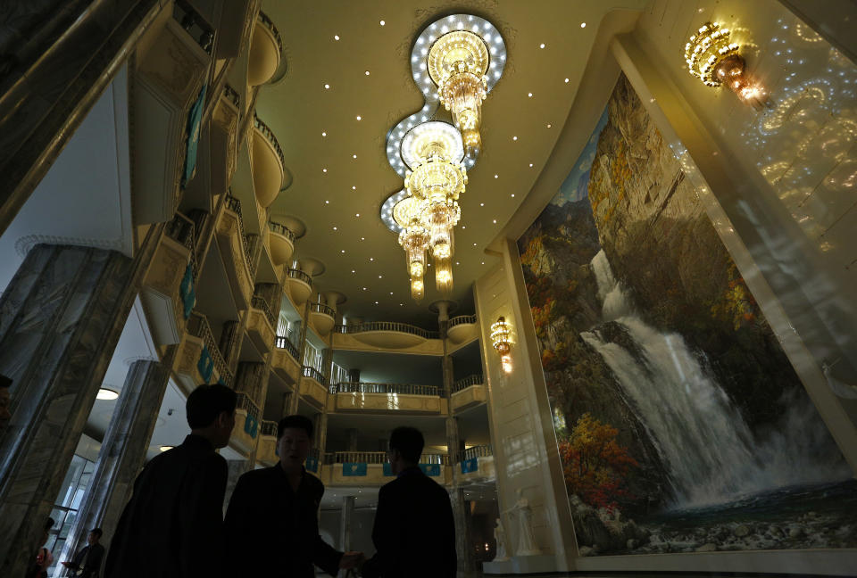 In this Sept. 20, 2012 photo, North Koreans stand at the lobby of the East Pyongyang Grand Theatre before the opening ceremony of 13th Pyongyang film festival in Pyongyang, North Korea. (AP Photo/Vincent Yu)