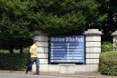 A man walks past the Richview Office Park which houses Western Union offices in Dublin