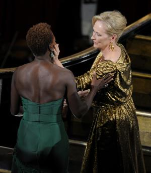 "CORRECTS NAME TO VIOLA DAVIS -- Meryl Streep, right, is congratulated by Viola Davis before accepting the Oscar for best actress in a leading role for ""The Iron Lady"" during the 84th Academy Awards on Sunday, Feb. 26, 2012, in the Hollywood section of Los Angeles. (AP Photo/Mark J. Terrill)"