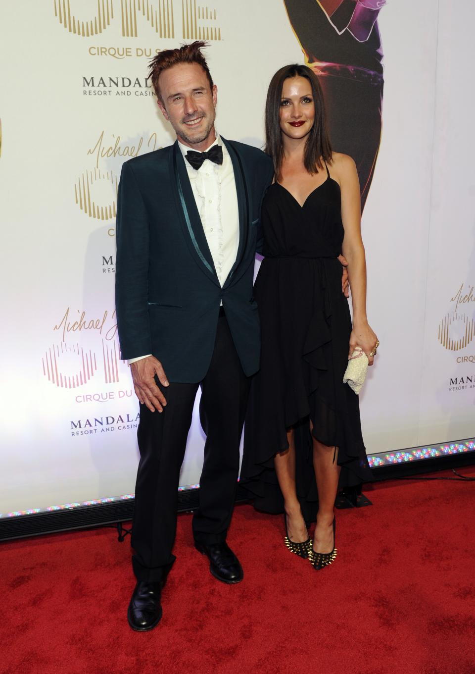 "Actor David Arquette, left, and television personality Christina McLarty arrive at the world premiere of ""Michael Jackson ONE"" at THEhotel at Mandalay Bay Resort and Casino on Saturday, June 29, 2013 in Las Vegas. (Photo by David Becker/Invision/AP)"