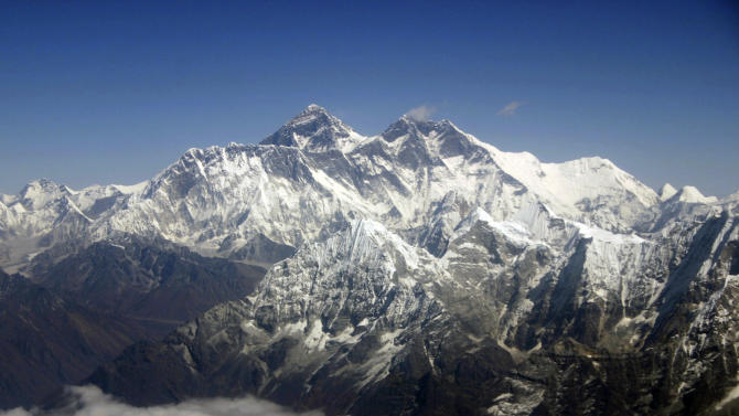 FILE - This Oct. 21, 2005 file photo shows Mount Everest from an aerial view taken over Nepal. Climbers attempting to scale the world's highest peak now have access to high-speed Internet near its 17,000-foot (5,200-meter) base camp, the last gathering point on the journey to the top. Ncell, a subsidiary of Swedish telecom company TeliaSonera, announced Friday Oct. 29, 2010 that they have set up seven 3G base stations in the Everest region, allowing climbers and trekkers to access wireless Internet and make video calls, for example over Skype. (AP Photo/Jody Kurash, File)