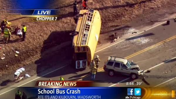 Rescue workers at scene of overturned school bus in Wadsworth