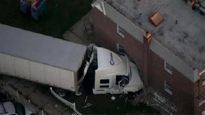 Crash sends tractor-trailer into house in Mayfair