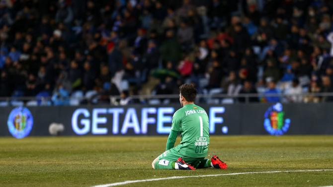 Getafe's goalkeeper Jonathan Lopez reacts after a missed opportunity against Villarreal during their Spanish King's Cup quarterfinal second leg soccer match in Getafe