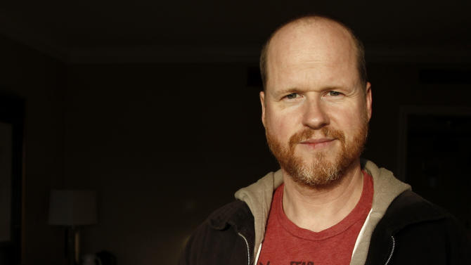 """FILE - In this May 4, 2012 file photo, writer and director, Joss Whedon, from the film """"The Avengers,"""" poses for a portrait in Beverly Hills, Calif.  Disney Executive Officer, Robert Iger, said on Tuesday, August 7, 2012, during a company earnings call, that Whedon is returning to write and direct the sequel adapted from the Marvel Comics tales. (AP Photo/Matt Sayles, File)"""