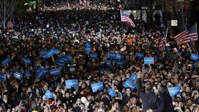 President Barack Obama and first lady Michelle Obama wave to supporter during the final 2012 campaign event in downtown Des Moines, Iowa, Tuesday, Nov. 6, 2012. (AP Photo/Pablo Martinez Monsivais)