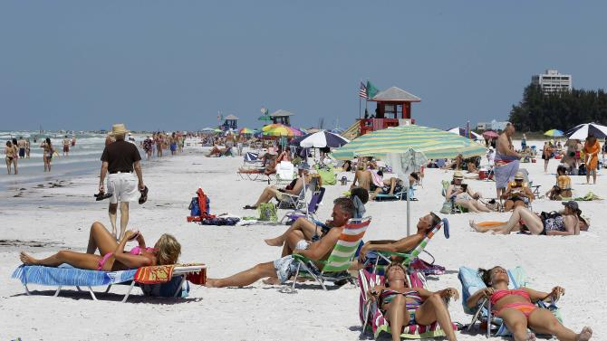 """This May 18, 2011 photo, shows the Siesta Key public beach in Sarasota, Fla.  Siesta Key is on the list of Top 10 Beaches produced annually by coastal expert Stephen P. Leatherman, also known as """"Dr. Beach,"""" director of Florida International University's Laboratory for Coastal Research. (AP Photo/Chris O'Meara)"""