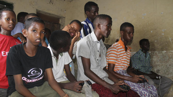 Somali children play video games at a game shop in Mogadishu, Somalia, Friday, May 4, 2012. Video games are the new rage in Somalia, a first-world entertainment option for teenage boys that wasn't permitted when ultraconservative al-Shabab militants controlled the capital. (AP Photo/Farah Abdi Warsameh)