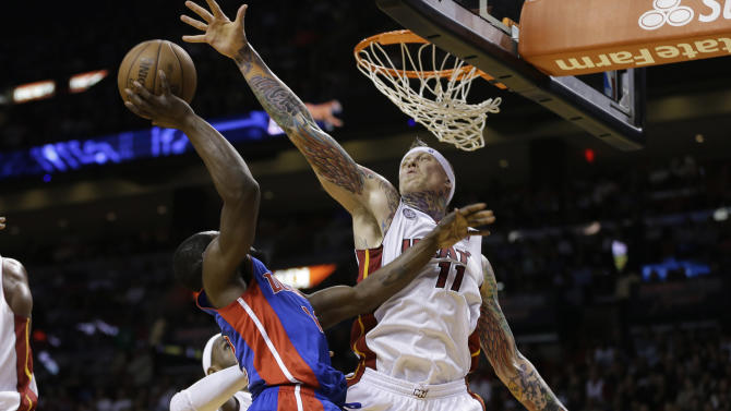 Miami Heat's Chris Anderson (11) blocks the shot of  Detroit Pistons' Will Bynum (12) during the second half of a NBA basketball game in Miami, Friday, March 22, 2013. The Heat won 103-89. (AP Photo/J Pat Carter)