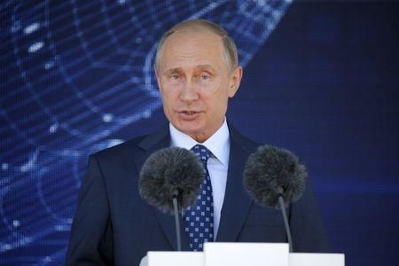 Higher prices dent Putin's sky-high popularity: paper