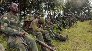 Congolese soldiers rest while being deployed against …